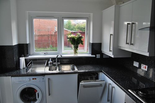 kitchen design with washing machine. A Shining New Hotpoint Four Burner Gas Hob And Built In Single  Oven Were Also Included Complete With A Glass Splashback Black Curved Cooker Avant White Kitchen Sparkly Worktops